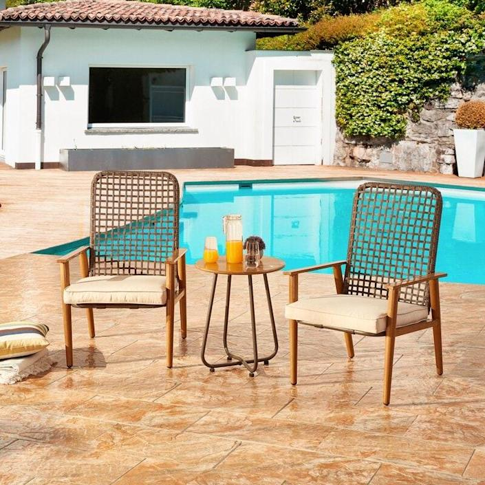 "$266, Wayfair. <a href=""https://www.wayfair.com/outdoor/pdp/bayou-breeze-hawes-3-piece-rattan-seating-group-with-cushions-w003001581.html"" rel=""nofollow noopener"" target=""_blank"" data-ylk=""slk:Get it now!"" class=""link rapid-noclick-resp"">Get it now!</a>"