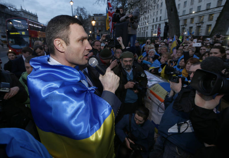 Ukraine's MP Vitali Klitschko, leader of the UDAR (Ukrainian Democratic Alliance for Reform) party addresses protesters outside 10 Downing Street in London after a meeting with British Prime Minister David Cameron and Foreign Secretary William Hague, Wednesday, March 26, 2014. (AP Photo/Sang Tan)