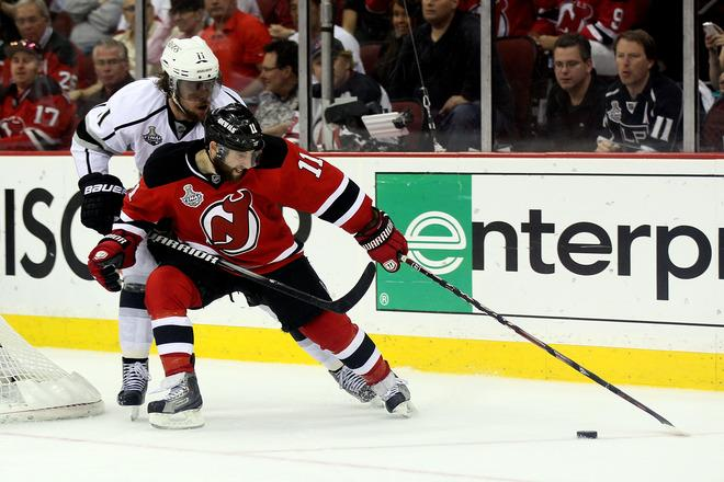 NEWARK, NJ - JUNE 09: Stephen Gionta #11 of the New Jersey Devils goes for a loose puck against Anze Kopitar #11 of the Los Angeles Kings during Game Five of the 2012 NHL Stanley Cup Final at the Prudential Center on June 9, 2012 in Newark, New Jersey.  (Photo by Elsa/Getty Images)