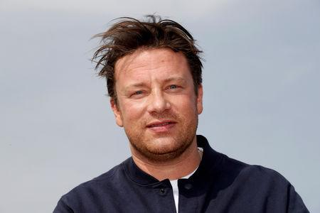 FILE PHOTO: Chef Jamie Oliver poses during a photocall at the annual MIPCOM television programme market in Cannes, France, October 15, 2018. REUTERS/Eric Gaillard/File Photo