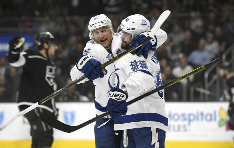 Tampa Bay Lightning right wing Nikita Kucherov, right, of Russia, is congratulated by center Steven Stamkos after scoring against the Los Angeles Kings during the first period of an NHL hockey game, Thursday, Nov. 9, 2017, in Los Angeles. (AP Photo/Michael Owen Baker)