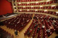 FILE - Spectators sit apart from each other to respect social distancing, prior to a show at the La Scala theater in Milan Italy, on July 6, 2020. La Scala opera house reopened after a four-month shutdown due to the COVID-19 restriction measures. (AP Photo/Antonio Calanni, File)