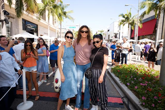 Kendall Jenner, Caitlyn Jenner and Kylie Jenner pose for a photo as Caitlyn Jenner displays her Austin-Healey Sprite at the Rodeo Drive Concours d'Elegance on June 18, 2017 in Beverly Hills, California. (Photo by Earl Gibson III/Getty Images)