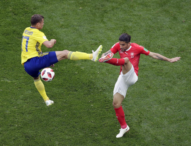 <p>Sweden's Viktor Claesson, left, duels for the ball with Switzerland's Ricardo Rodriguez during the round of 16 match between Switzerland and Sweden at the 2018 soccer World Cup in the St. Petersburg Stadium, in St. Petersburg, Russia, Tuesday, July 3, 2018. (AP Photo/Dmitri Lovetsky) </p>