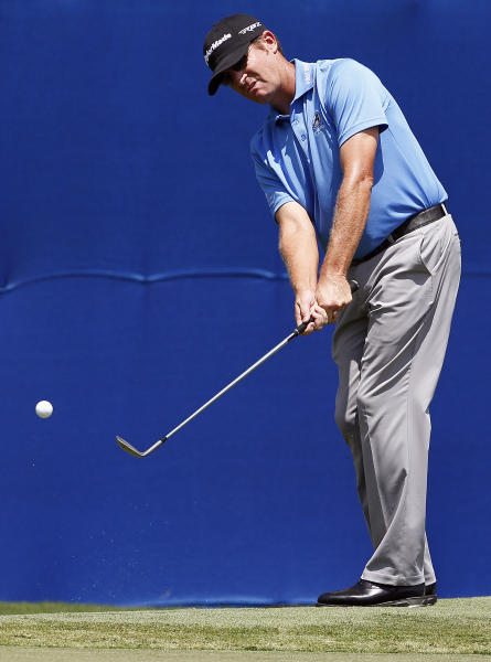 David Mathis chips on the 18th green during the first round of the Wyndham Championship golf tournament in Greensboro, N.C., Thursday, Aug. 16, 2012. (AP Photo/Gerry Broome)