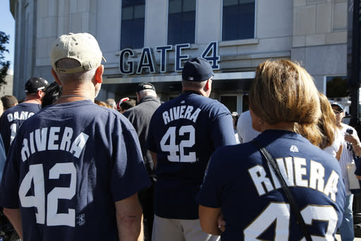 Fans of New York Yankees relief pitcher Mariano Rivera line up outside Yankee Stadium before their baseball game against the San Francisco Giants, Sunday, Sept. 22, 2013, in New York. The Yankees plan to honor Rivera in a retirement ceremony. (AP Photo/Kathy Willens)