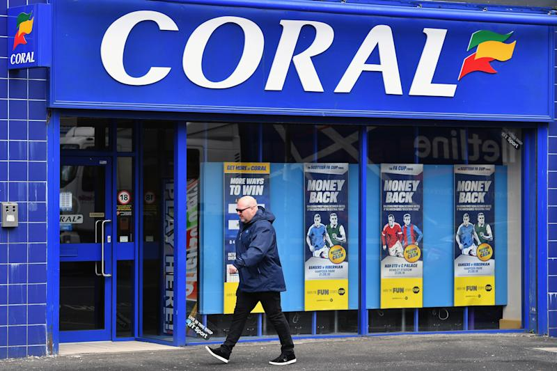 GLASGOW, SCOTLAND - MAY 20: A general view of a Coral bookmakers on May 20, 2016 in Glasgow,Scotland. The high street bookmakers Ladbrokes and Coral may have to shed hundreds of jobs if their proposed merger is to go ahead, restricting competition in the business. (Photo by Jeff J Mitchell/Getty Images)