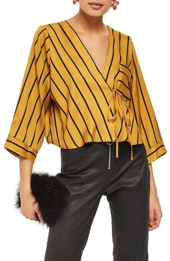 """Get it <a href=""""https://shop.nordstrom.com/s/topshop-stripe-tie-wrap-kimono-top/4871581?origin=category-personalizedsort&amp;fashioncolor=MUSTARD%20MULTI"""" target=""""_blank"""">here</a>.&nbsp;"""