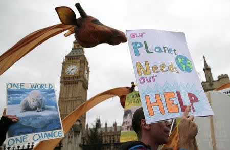 Protesters demonstrate during a rally held the day before the start of the Paris Climate Change Summit, in London