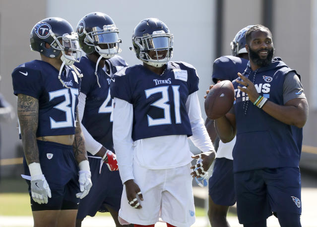 "Tennessee Titans defensive back Kevin Byard (31) waits for his turn to run a drill during NFL football training camp Tuesday, Aug. 7, 2018, in Nashville, Tenn. Byard has been called just a ""fan"" on Twitter by Hall of Famer Deion Sanders. Well, Byard is busy working hard for a follow-up to his second season in the NFL when he tied for the league-lead with eight interceptions earning both All Pro and Pro Bowl honors. (AP Photo/Mark Humphrey)"