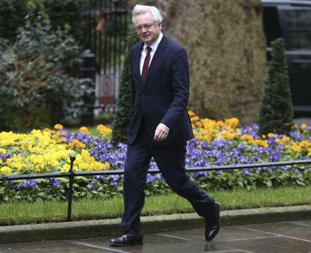 Britain's Secretary of State for departing the European Union David Davis arrives at 10 Downing Street for a cabinet meeting ahead of the budget in London
