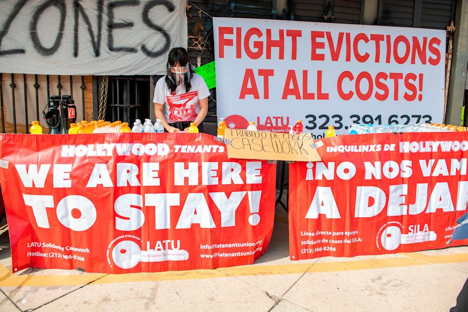 <p>Members of the Los Angeles Tenants Union protest against evictions and give out food for the homeless on February 8, 2021 in Hollywood, California. </p> ((Photo by VALERIE MACON / AFP) )