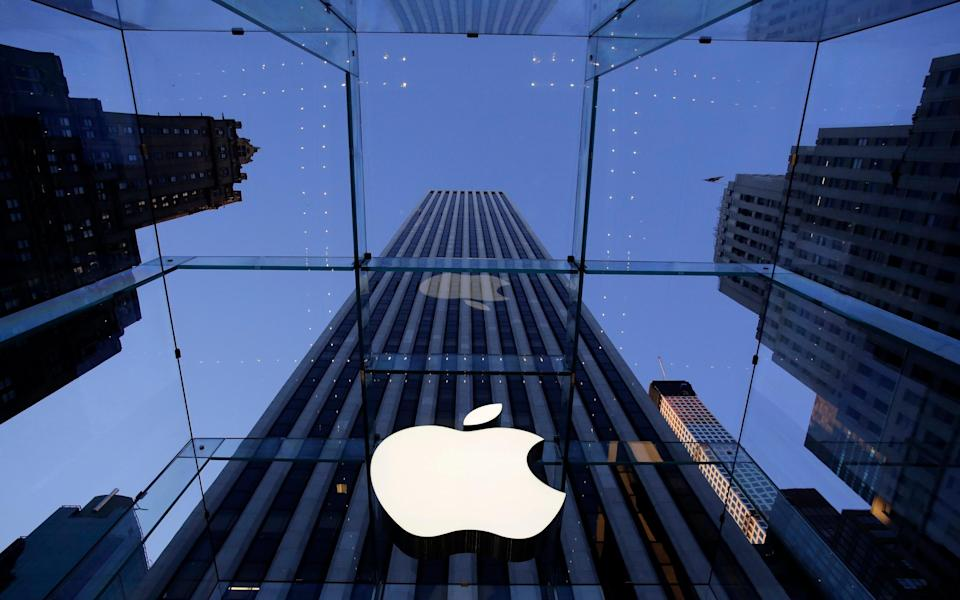 The Apple logo hangs in the glass box entrance to the company's Fifth Avenue store in New York