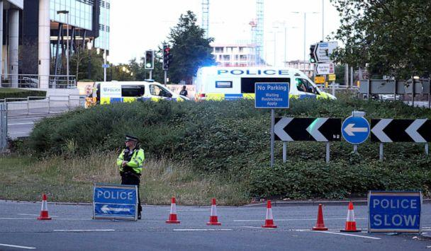 PHOTO: Police investigate near Forbury Gardens in the town centre of Reading, England, where they are responding to a 'serious incident' Saturday, June 20, 2020. (Steve Parsons/PA via AP)