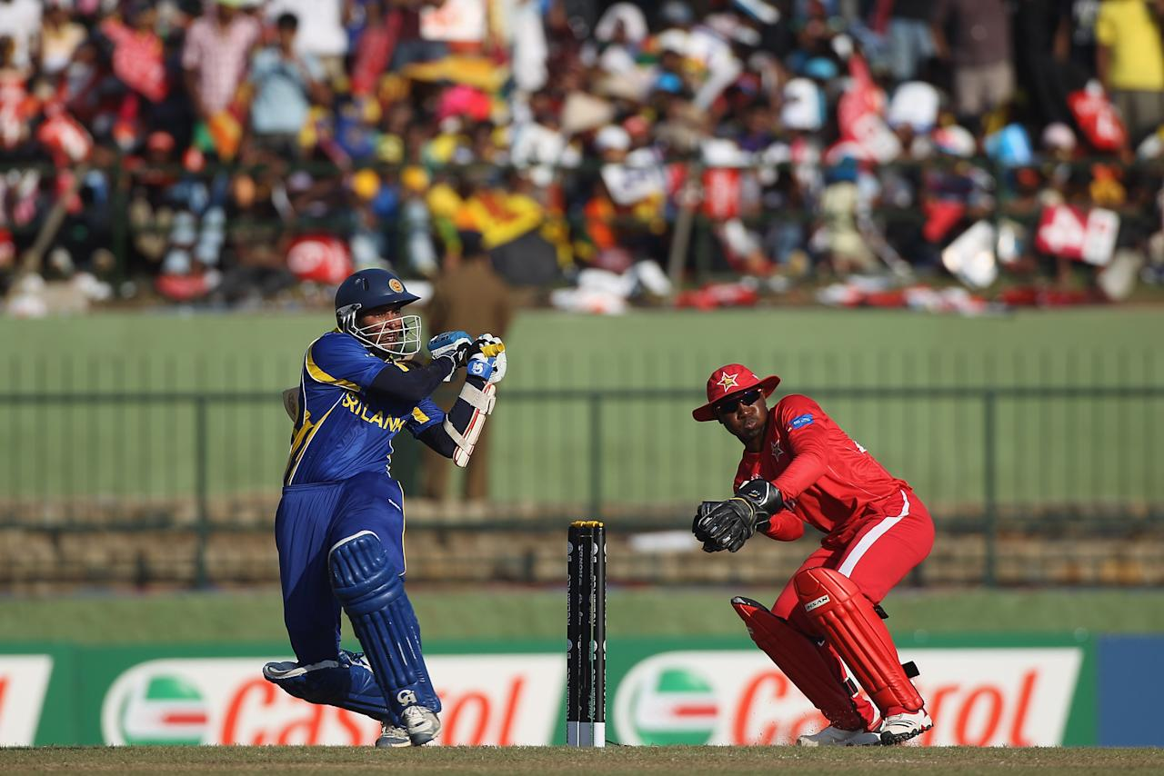 KANDY, SRI LANKA - MARCH 10:  Tillakaratne Dilshan (L) of Sri Lanka plays to the legside as wicketkeeper Tatenda Taibu (R) looks on during the Sri Lanka v Zimbabwe 2011 ICC World Cup Group A match at the  Pallekele Cricket Stadium on March 10, 2011 in Kandy, Sri Lanka.  (Photo by Michael Steele/Getty Images)