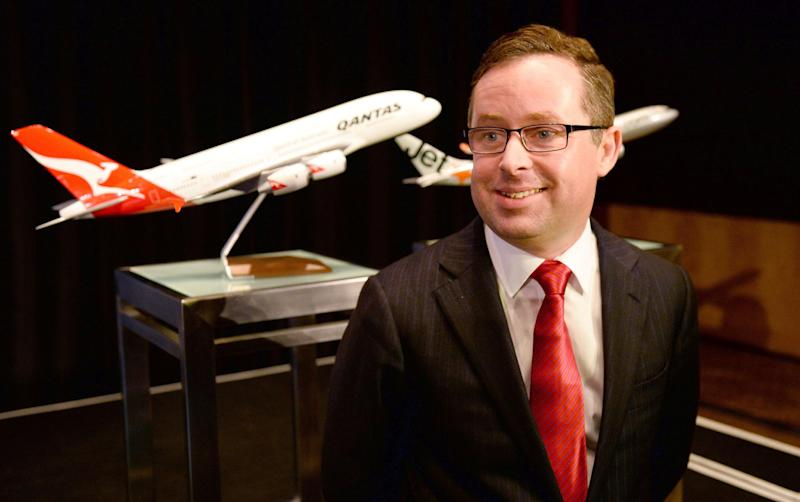 Qantas chief executive Alan Joyce poses in front of a model Airbus A380 in Sydney, February 2013