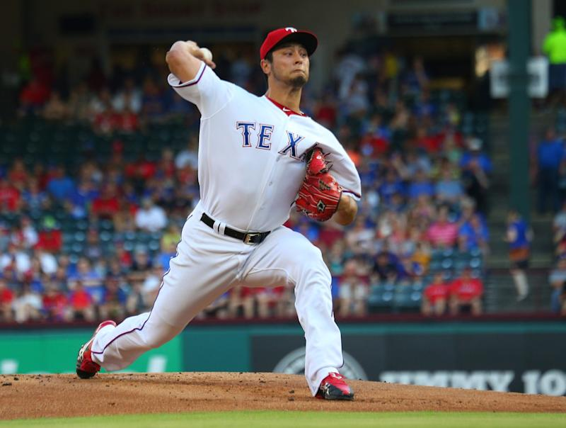 Yu Darvish #11 of the Texas Rangers throws in the first inning against the New York Mets at Globe Life Park in Arlington on June 7, 2017 in Arlington, Texas.