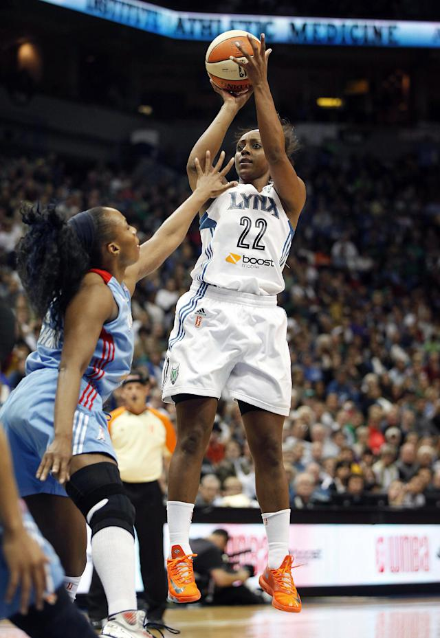 Minnesota Lynx guard Monica Wright (22) takes a shot against Atlanta Dream forward Le'coe Willingham (43) during Game 1 of the WNBA basketball finals, Sunday, Oct. 6, 2013, in Minneapolis. The Lynx won 84-59. (AP Photo/Stacy Bengs)