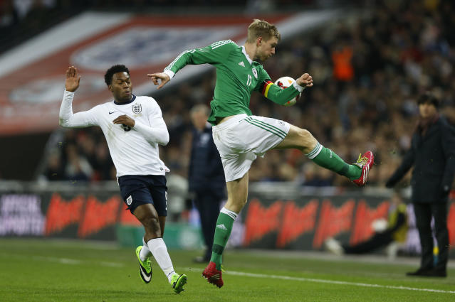 Germany's Per Mertesacker, right, clears the ball away from England's Daniel Sturridge during the international friendly soccer match between England and Germany, at Wembley Stadium in London, Tuesday, Nov. 19, 2013. (AP Photo/Kirsty Wigglesworth)