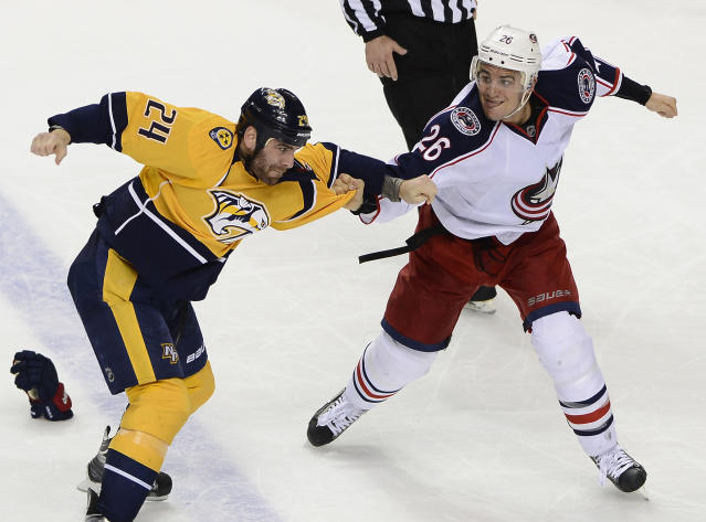 Nashville Predators forward Eric Nystrom (24) fights with Columbus Blue Jackets forward Corey Tropp (26) in the second period of an NHL hockey game on Saturday, March 8, 2014, in Nashville, Tenn. (AP Photo/Mark Zaleski)