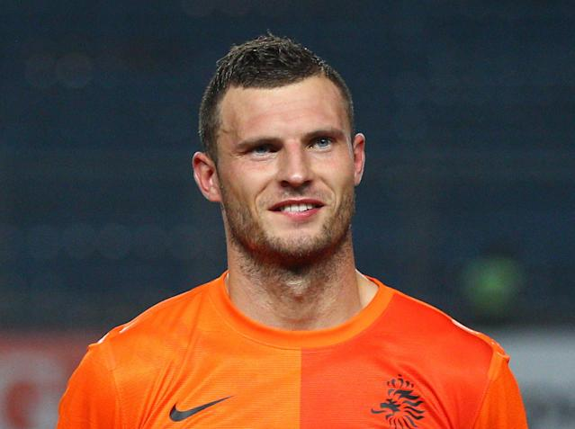 Erik Pieters of the Netherlands lines up before his friendly soccer match against Indonesia at Gelora Bung Karno stadium in Jakarta, Indonesia, Friday, June 7, 2013. (AP Photo/Dita Alangkara)