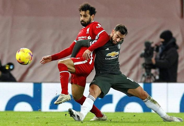 Stalemate: Mohamed Salah (left)and Bruno Fernandes (right)failed to break the deadlock in a 0-0 draw between Liverpool and Manchester United