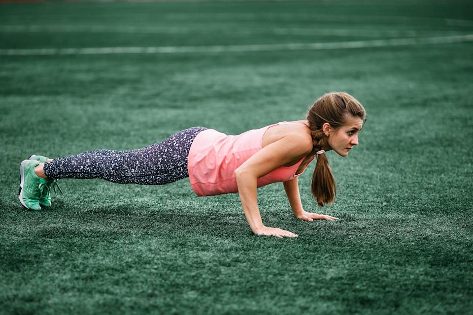 """<p>The sprawl is basically a burpee on steroids—a full body exercise that works as many muscles as possible and burns calories while shaping and toning upper- and lower-body, especially your abs. """"It takes the traditional burpee to the next level by having you touch your chest to the ground, then push-up to plank as you continue the move,"""" explains Braganza.</p><p><strong>How to do a sprawl: </strong>Standing with your feet shoulder-distance apart, squat down and place your hands on the ground. Jump your feet back to a plank and lower your body to touch the ground. Push yourself up to a plank and then jump your feet outside of your hands into a squat. Stand back up. That's one rep. """"If you want to burn even more calories, add a jump between each sprawl,"""" Braganza adds.</p>"""