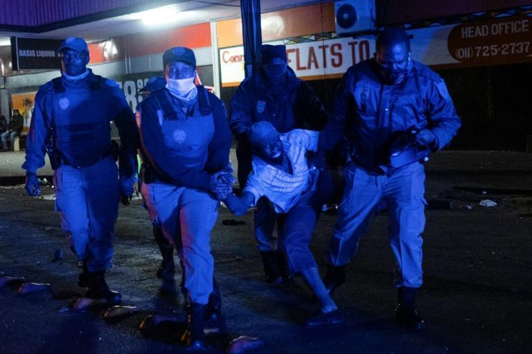 Johannesburg police detaining a suspected looter in the city's business district