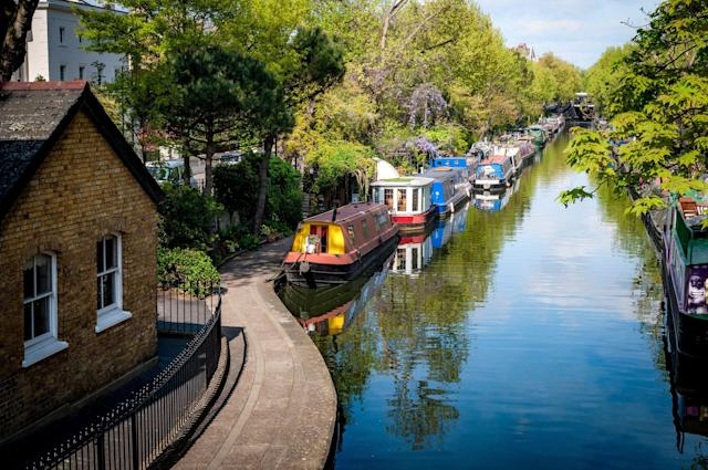 Rows of houseboats on the banks of Regent's Canal in Little Venice, London. Photo: Getty