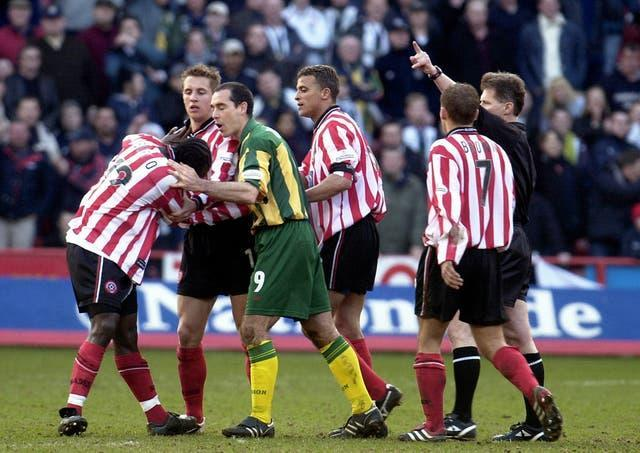 Sheffield United's Patrick Suffo (left) becomes the third player to be sent off