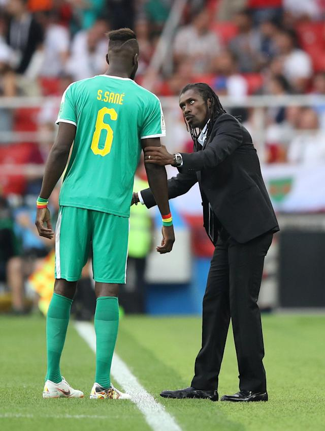 Soccer Football - World Cup - Group H - Poland vs Senegal - Spartak Stadium, Moscow, Russia - June 19, 2018 Senegal coach Aliou Cisse talks with Salif Sane REUTERS/Carl Recine