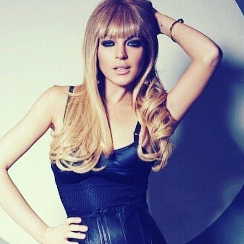 Lindsay Lohan poses in a black top