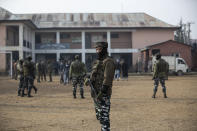 Indian soldiers stand guard outside a polling station during the first phase of District Development Councils election on the outskirts of Srinagar, Indian controlled Kashmir, Saturday, Nov. 28, 2020. Thousands of people in Indian-controlled Kashmir voted Saturday amid tight security and freezing cold temperatures in the first phase of local elections, the first since New Delhi revoked the disputed region's semiautonomous status. (AP Photo/Mukhtar Khan)