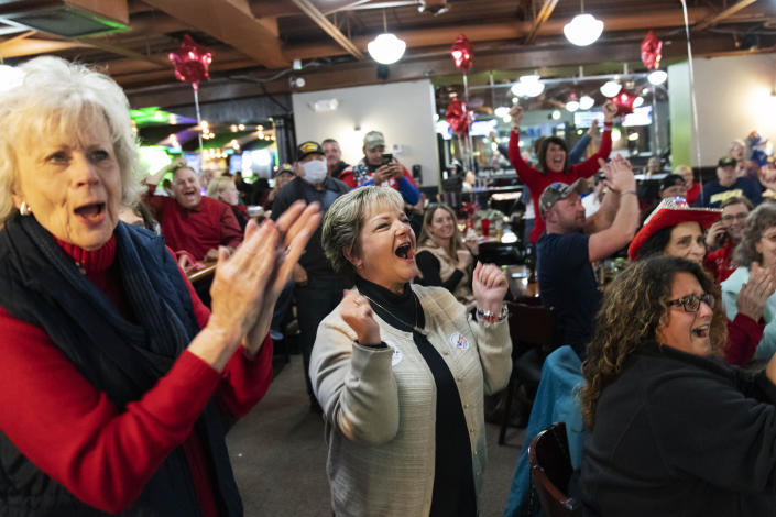 Supporters of President Donald Trump cheer while watching election results at a watch party in Shelby Township, Mich., Tuesday, Nov. 3, 2020. (AP Photo/David Goldman)