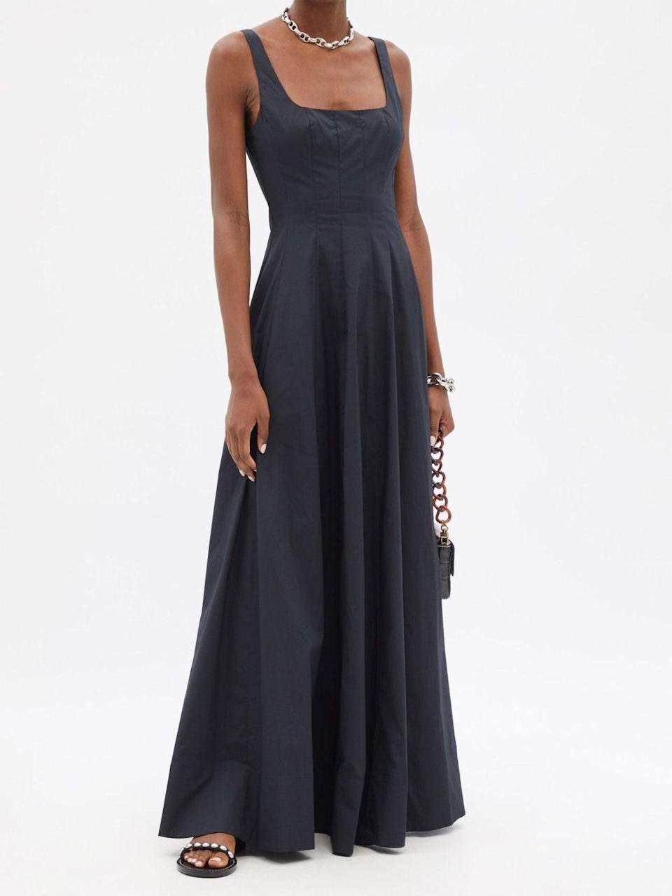 """Let's take a moment to appreciate this floor-length gown that's perfect for fall and winter weddings. The minimalist A-line silhouette is a mainstay in the Staud collection—and in classic black, its versatility knows no bounds. Add a <a href=""""https://www.glamour.com/story/best-affordable-jewelry-brands?mbid=synd_yahoo_rss"""" rel=""""nofollow noopener"""" target=""""_blank"""" data-ylk=""""slk:chunky chain"""" class=""""link rapid-noclick-resp"""">chunky chain</a> to play up the square neckline, or revel in its simplicity with a statement cuff and <a href=""""https://www.glamour.com/gallery/tiny-bags-trend?mbid=synd_yahoo_rss"""" rel=""""nofollow noopener"""" target=""""_blank"""" data-ylk=""""slk:tiny bag"""" class=""""link rapid-noclick-resp"""">tiny bag</a>. $295, Matches Fashion. <a href=""""https://www.matchesfashion.com/us/products/Staud-Wells-cotton-poplin-maxi-dress-1436093"""" rel=""""nofollow noopener"""" target=""""_blank"""" data-ylk=""""slk:Get it now!"""" class=""""link rapid-noclick-resp"""">Get it now!</a>"""
