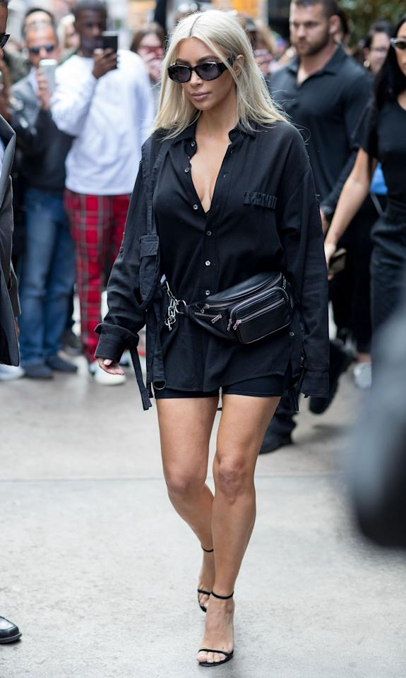 <p>In an oversized black shirt over a pair of shorts, a fanny pack, oval glasses, an minimalist heeled sandals while out in New York.</p>
