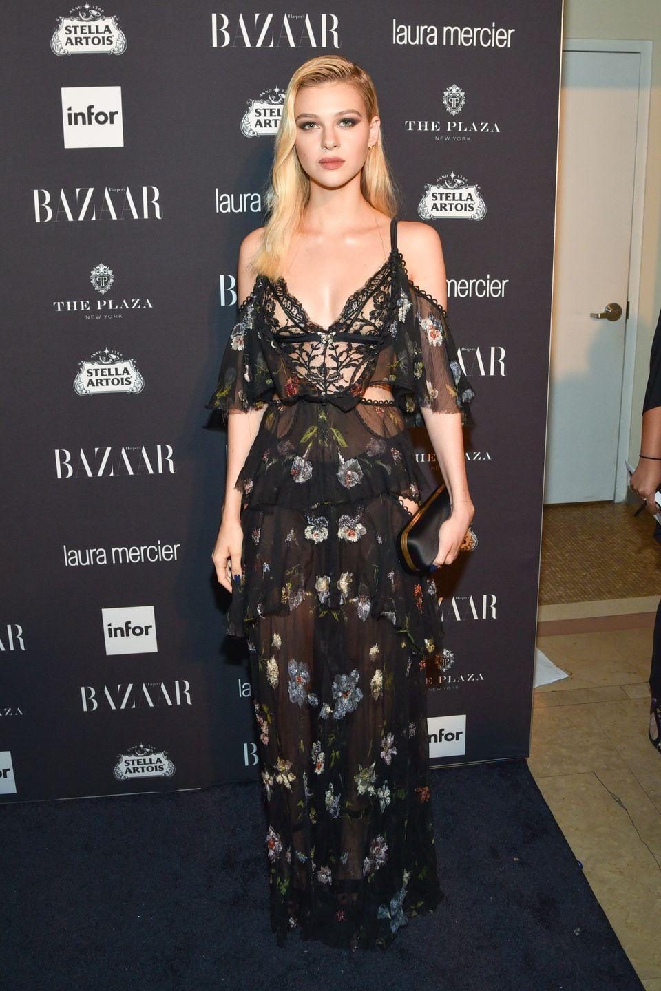 <p>The star wore an off-the-shoulder, black floral-printed floor-length dress to the star-studded event. She styled the look with a black satin clutch bag. </p>