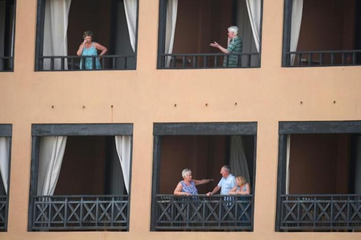 Officials said the guests would remain shut in the hotel until the results of a second coronavirus test came through later on Tuesday (AFP Photo/DESIREE MARTIN)
