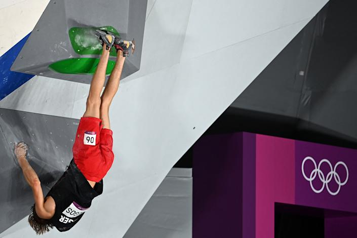 <p>Germany's Alexander Megos competes in the men's sport climbing bouldering qualification during the Tokyo 2020 Olympic Games at the Aomi Urban Sports Park in Tokyo on August 3, 2021. (Photo by MOHD RASFAN / AFP) (Photo by MOHD RASFAN/AFP via Getty Images)</p>