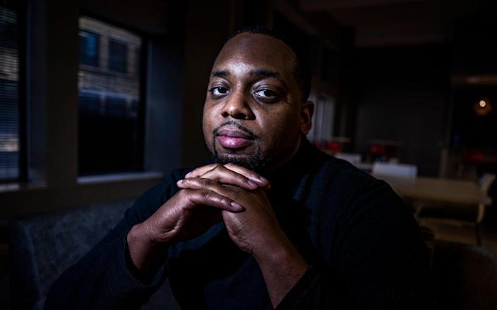 Brandon Mitchell, a juror in the trial of former Minneapolis police Officer Derek Chauvin for the killing of George Floyd, poses for a picture, in Minneapolis - AP