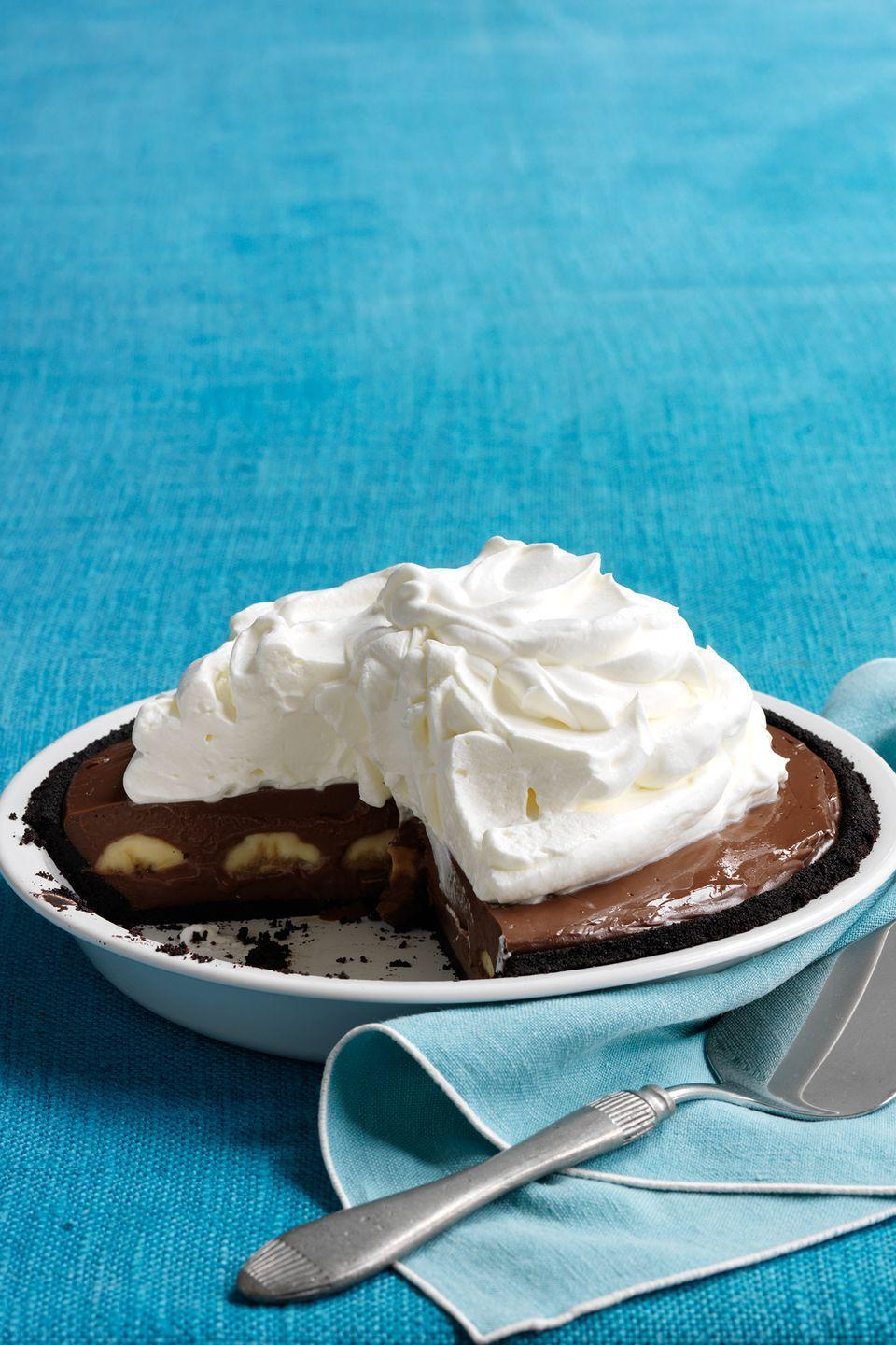 "<p>Your Thanksgiving guests will be surprised and delighted when they bite into this rich pie and discover its chocolate wafer <a href=""https://www.countryliving.com/food-drinks/g3845/thanksgiving-cookies/"" rel=""nofollow noopener"" target=""_blank"" data-ylk=""slk:cookie"" class=""link rapid-noclick-resp"">cookie</a> crust.</p><p><strong><a href=""https://www.countryliving.com/food-drinks/recipes/a33398/double-chocolate-banana-cream-pie-recipe/"" rel=""nofollow noopener"" target=""_blank"" data-ylk=""slk:Get the recipe"" class=""link rapid-noclick-resp"">Get the recipe</a>.</strong></p><p><a class=""link rapid-noclick-resp"" href=""https://www.amazon.com/Camp-Chef-True-Seasoned-CIPIE10/dp/B000OXAQ6G?tag=syn-yahoo-20&ascsubtag=%5Bartid%7C10050.g.957%5Bsrc%7Cyahoo-us"" rel=""nofollow noopener"" target=""_blank"" data-ylk=""slk:SHOP PIE PANS"">SHOP PIE PANS</a> </p>"