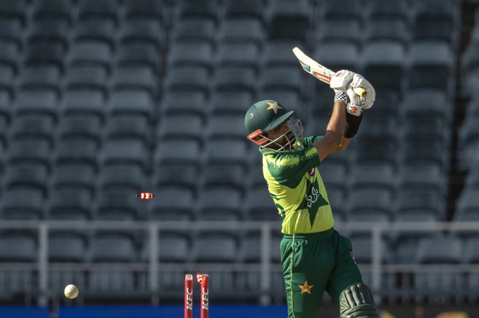 Pakistan's captain Babar Azam is bowled out by South Africa's bowler Sisanda Magala for 50 runs during the second T20 cricket match between South Africa and Pakistan at the Wanderers stadium in Johannesburg, South Africa, Monday, April 12, 2021. (AP Photo/Themba Hadebe)