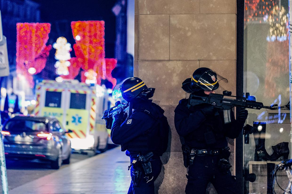 French police officers stand guard near the scene of a shooting on Dec. 11, 2018 in Strasbourg, eastern France. (Photo: Abdesslam Mirdass/AFP/Getty Images)