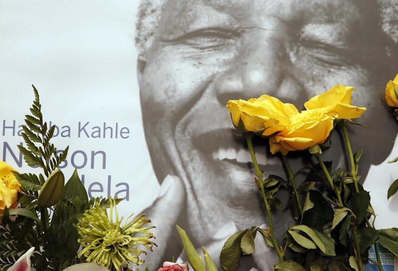 A portrait former president Nelson Mandela, placed outside his residence in Johannesburg, South Africa, Monday, Dec. 9, 2013. Mandela died Thursday Dec. 5 at his Johannesburg home after a long illness. He was 95. (AP Photo/Themba Hadebe)
