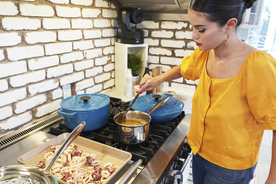 "This image released by HBO Max shows Selena Gomez from ""Selena + Chef,"" a 10-episode cooking series that debuts Thursday on the HBO Max streaming service. (HBO Max via AP)"