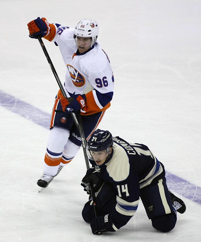 Columbus' Blake Comeau (14) has his stick held by New York Islanders' Pierre-Marc Bouchard (96) during the third period of an NHL hockey game Saturday, Nov. 9, 2013, in Columbus, Ohio. (AP Photo/Mike Munden)