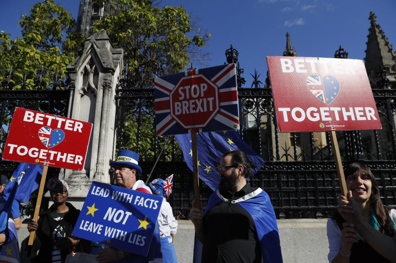 Ani-Brexit protesters demonstrate outside the Houses of Parliament in London, Thursday, Sept. 12, 2019.European Parliament President David Sassoli says British Prime Minister Boris Johnson's government has made no new proposals that would unblock Brexit talks and that talking about removing the so-called backstop from the divorce agreement is a waste of time. (AP Photo/Alastair Grant)