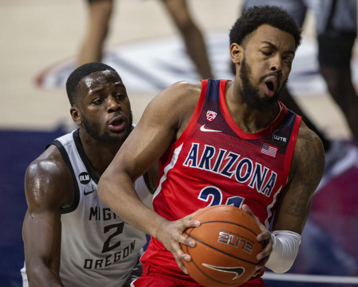 Oregon forward Eugene Omoruyi (2) guards Arizona forward Jordan Brown (21) in the corner of the court during an NCAA college basketball game, Saturday, Feb. 13, 2021, in Tucson, Ariz. (Josh Galemore/Arizona Daily Star via AP)