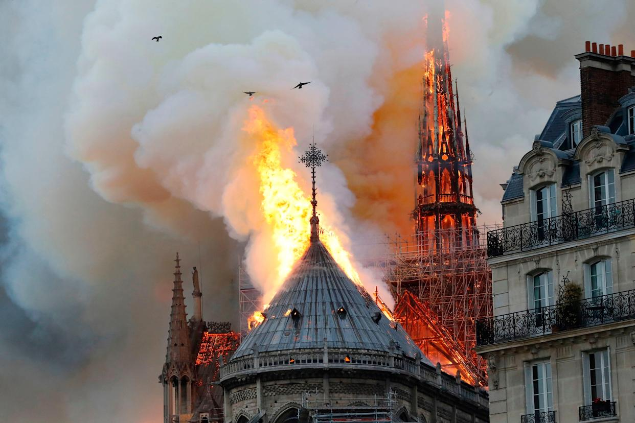 Smoke and flames engulf the landmark Notre Dame Cathedral on Monday. (Photo: Pierre Galey/AFP/Getty Images)