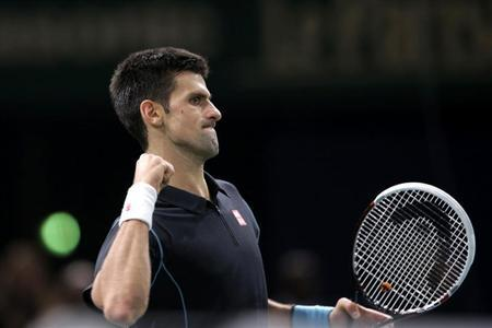 Djokovic reacts as he plays Ferrer in the men's singles final match at the Paris Masters men's singles tennis tournament in Paris